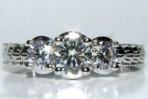 1.09CT DIAMONDS CLASSIC 3 RING