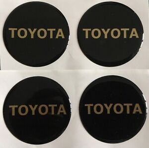 TOYOTA ALLOY WHEEL CENTRE CAP DOMED STICKERS X4 YARIS AYGO RAV4 BLACK GOLD 50mm
