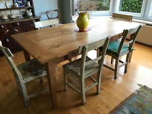 Beautiful table made from reclaimed Indonesian teak shutters.