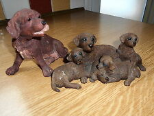 Two Chocolate Labrador figures. The puppies are Sherratt and Simpson.