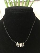 FOSSIL BRAND,AUTHENTIC,SILVER TONE, CRYSTAL ACCENTS MULTI RINGS STRING NECKLACE.