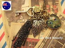 Women BOHO Peacock Heart Key Leaf Retro Vintage Necklace Long Chain Pendant