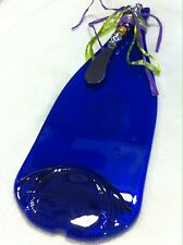 Slumped flattened cobalt blue wine bottle cheese tray with knife melted