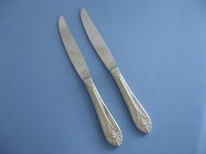 Two NEW YORK stainless dinner knives fan plume shell Oneida Korea