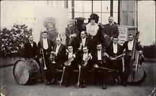 Riley Yorkshire Music Orchestra Band Pose w/ Posters Real Photo Postcard c1910