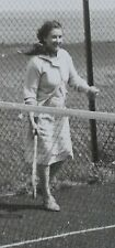 Vintage 60s B/W Photograph. Woman on a Tennis Court (Not Sporting Clothes)