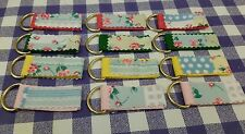 key fobs/key rings,green/yellow /pink, cord,floral fabric