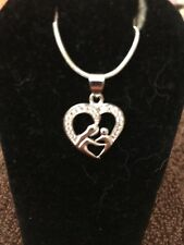 Silver Mother And Baby Enclosed In A Heart-Shaped Pendant Necklace