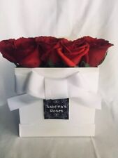 Fresh Cut Roses in a beautiful box arrangement.