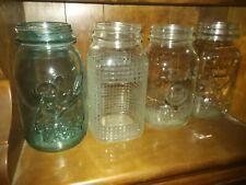 Set of four vintage mason jars