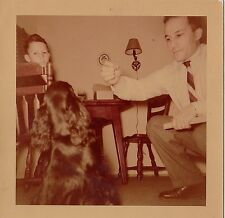 Vintage Photograph Man Giving Treat and Teaching Tricks To Cute Puppy Dog 1955
