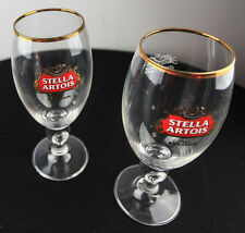 2 NEW STELLA ARTOIS BELGIUM BEER GLASSES GOLD RIMMED SHOOTERS WINE IMPORTS