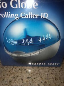 Sharper Image InfoGlobe Scrolling Caller ID BLUE WI701 Sealed Box