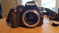 Nikon D3100 Digital SLR Camera with lens and bag