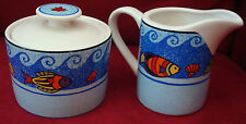 NEW creamer and covered sugar bowl, Sango, multicolor Fish and Wave Design