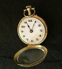 montre gousset de col or poinçon 18k tete de mercure