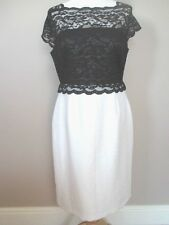 Hermosa Gina Bacconi de encaje negro con falda blanca brillante UK 14 EUR 42 US 10