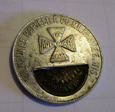 Rare Indian Head Penny Encased in a Milwaukee Harvester Co. token