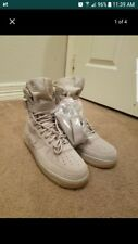 Mens Nike Special Forces size 9 color is tan , never been worn , comes with stra