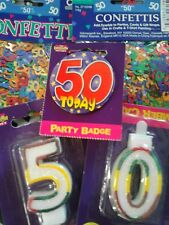 50th birthday confetti, badge and candle
