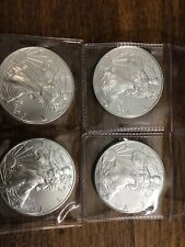 Lot of (4) 2016 US Silver Eagles -- BU