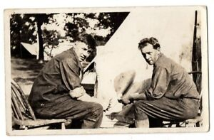 053121 WWI VINTAGE RPPC TWO SOLDIERS PEELING POTATOES BY TENT REAL PHOTO MILITAR