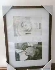 Walnut tone wood frame with white mat for two 5 x 7 openings/glass/backing