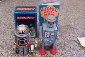 2 VINTAGE TINPLATE CLOCKWORK ROBOTS .SCHYLLING ATOMIC MAN & ROBOT 7 MINT IN BOX