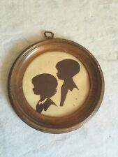 Vintage Child's Silhouette wall hanging of boy & girl  in round frame