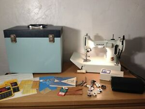 A lovely white Singer Featherweight with case and accessories - Model 221K