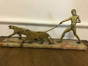 Rare Art Deco table sculpture 'Man walking with two leopards'