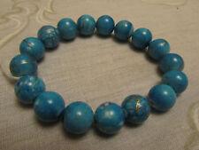 Blue & Gold Spattered Plastic Bead Elasticated Bracelet