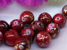 20x ACRYLIC ROUND BEADS, RED WITH BLACK, GOLD AND SILVER SPOTS, 10mm