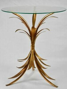 Vintage gold foliage coffee or martini table with glass top
