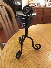 A THICK BLACK METAL PILLAR CANDLE HOLDER WITH 3 SCROLLED FEET#D