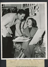 ERROL FLYNN + ROMANIAN PRINCESS GHIKA - 1950 CANDID - SELECTING WARDROBE