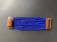 Handmade wide hardwood clasp with multi-strand sapphire glass beaded bracelet