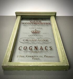 VINTAGE FRENCH WINDOW WITH PARISIAN CAFE SOCIETY GRAPHICS. CHAMPAGNE, MONTMARTRE
