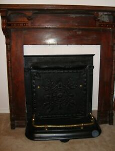 Antique New Orleans style Fireplace wood mantle, metal screen with brass