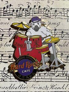Hard Rock Cafe - Osaka   White Sheep Wearing Hat & Playing Drums