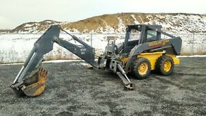 2002 New Holland LS180 Skid Steer. Bobcat with BackHoe Attachment .
