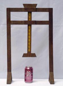Unusual, folky, decorative, dressmaker's tool for measuring hem lengths.