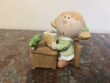 Collectible  Figurine - Girl Siiting At School Desk Reading The Frog Prince