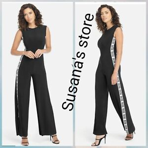 NWT BEBE LOGO SIDE STRIPE JUMPSUIT SIZE S Sleek, sporty and sexy Look!!