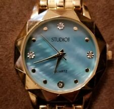 Studio Time ladies watch gold tone band abalone blue face gold tone case beveled