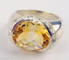 Edler Damenring, 925 Silber, gestempelt, mit Citrin und Steinchen besetzt