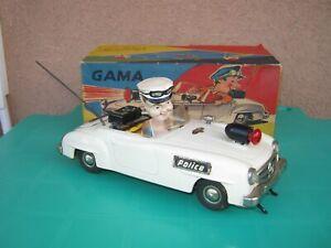 Gama 104 police tin toy car battery