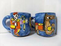 Two Rare La Musa Carnevale Saks Fith Avenue Italian Hand Painted Pottery Mugs
