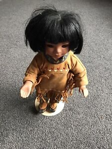 """Catori American Porcelain Red Indian Doll / Figurine on a stand 12.5 """" in height"""