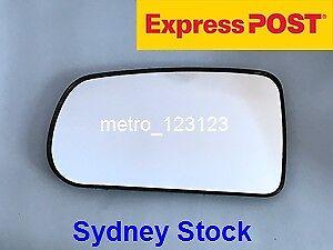 LEFT PASSENGER SIDE MIRROR GLASS FOR MAZDA 323 BJ 1998 - 2003